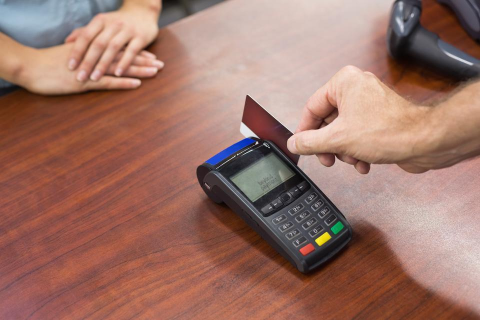 """""""Woman at cash register paying with credit card"""" stock image"""