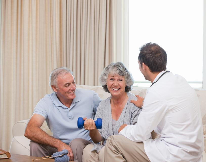 """""""Handsome doctor helping his patient to do exercises"""" stock image"""