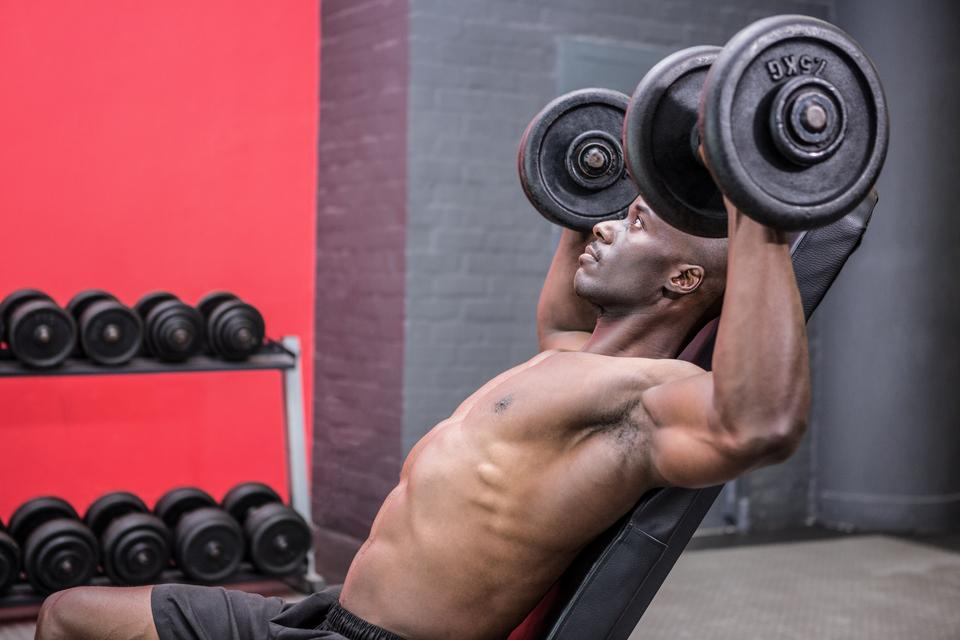 """Young Bodybuilder doing weightlifting"" stock image"