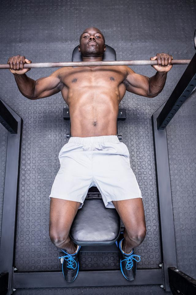 """""""Young Bodybuilder doing weightlifting"""" stock image"""