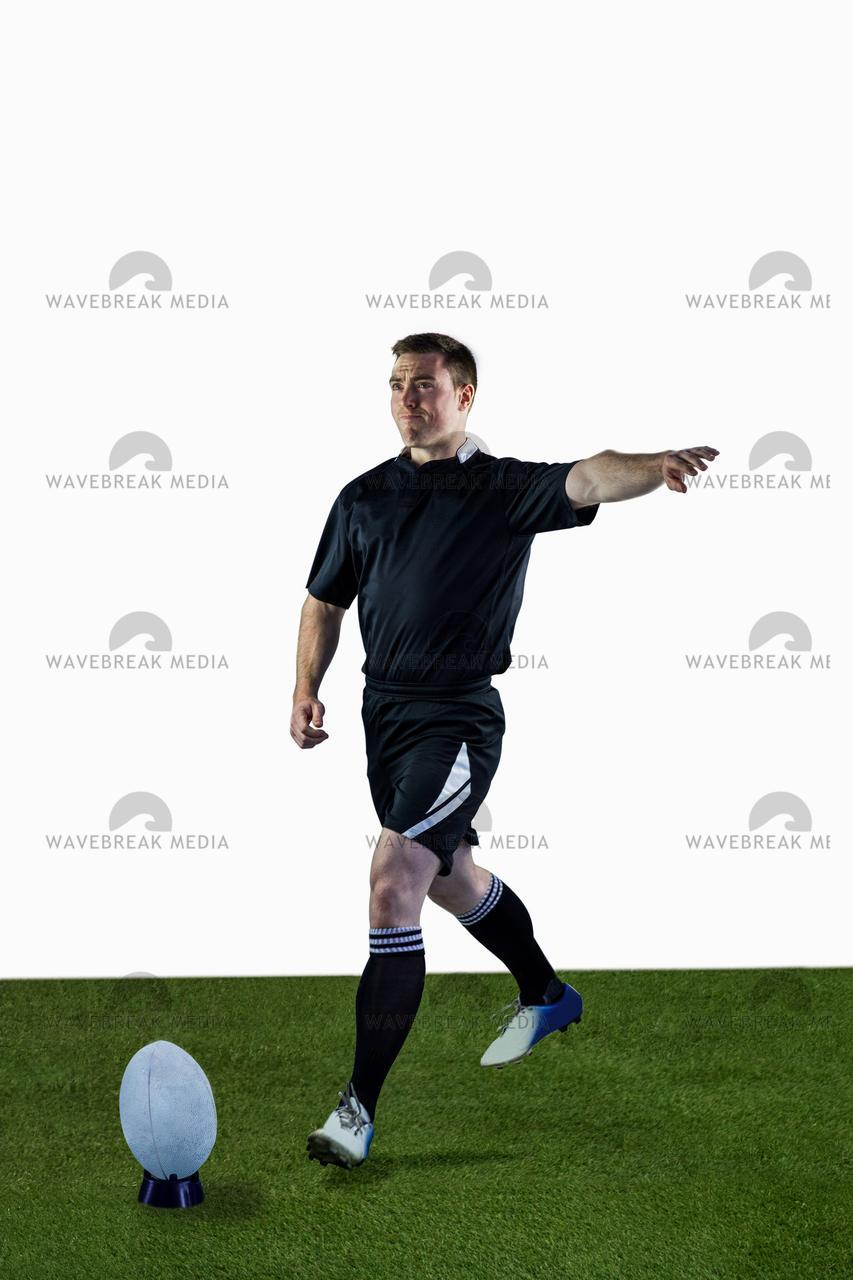Rugby player doing a drop kick - License, download or print