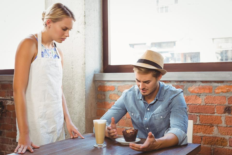 """""""Handsome hipster complaining to blonde waitress"""" stock image"""