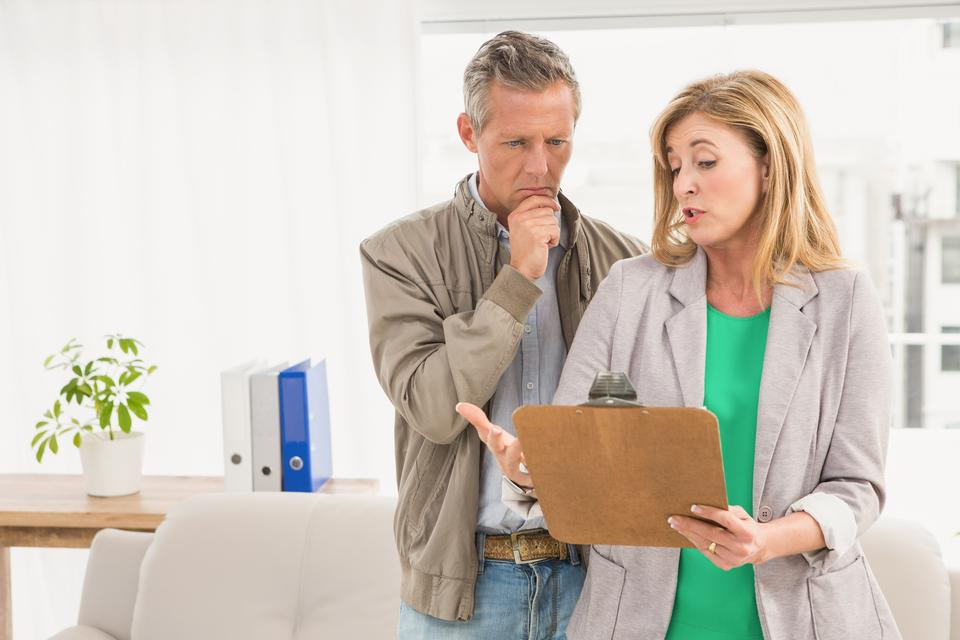"""""""Casual business colleagues looking at clipboard"""" stock image"""