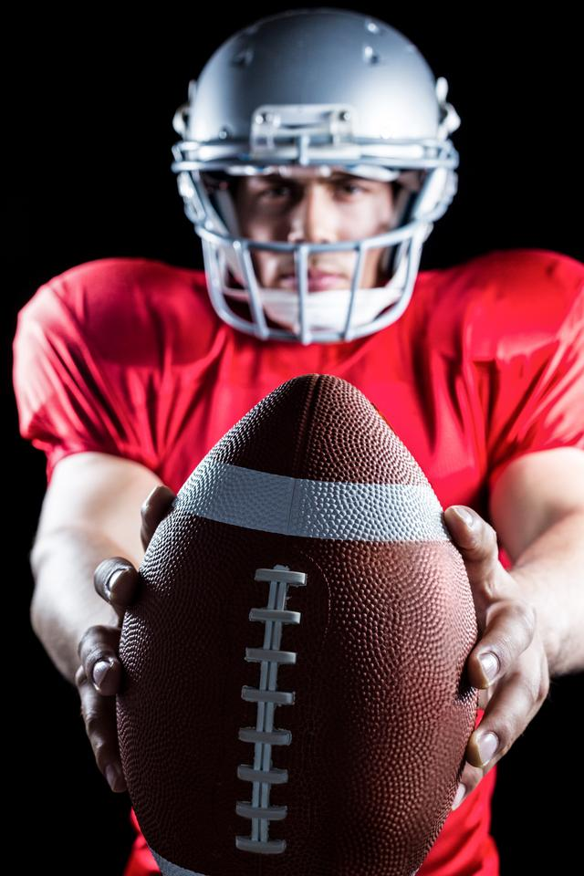 """""""Portrait of sportsman showing American football"""" stock image"""