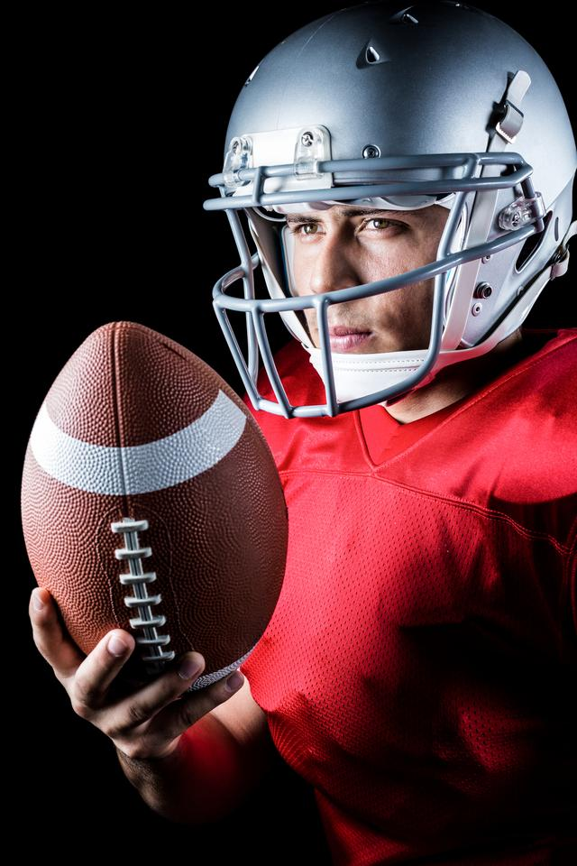 """""""Confident American football player with ball"""" stock image"""