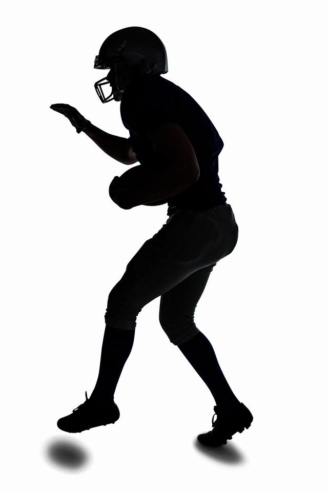 """""""Silhouette sportsman playing American football"""" stock image"""