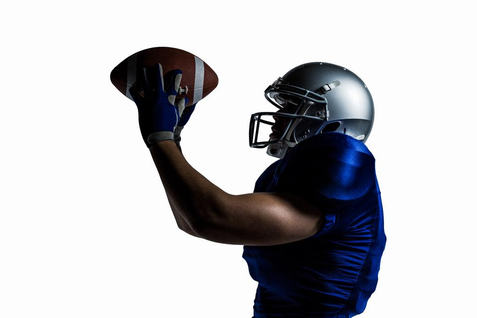 """""""American football player catching ball"""" stock image"""