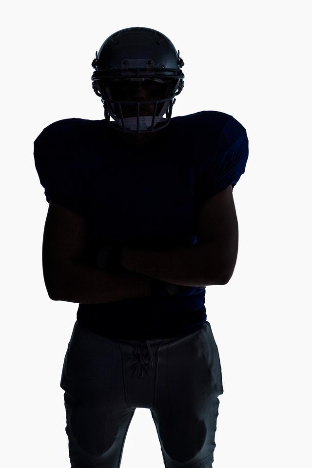 """""""Silhouette American football player standing"""" stock image"""