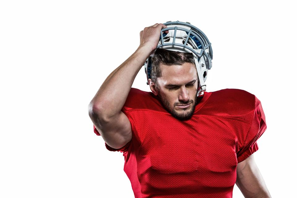 """""""American football player in removing helmet"""" stock image"""