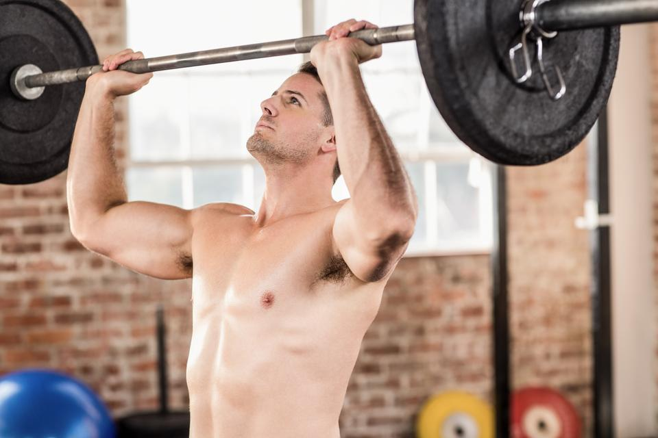 """""""Muscular man doing weightlifting"""" stock image"""