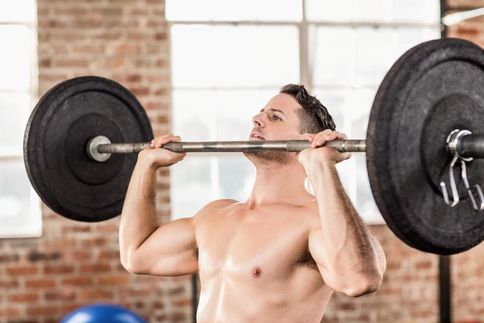 """Muscular man doing weightlifting"" stock image"