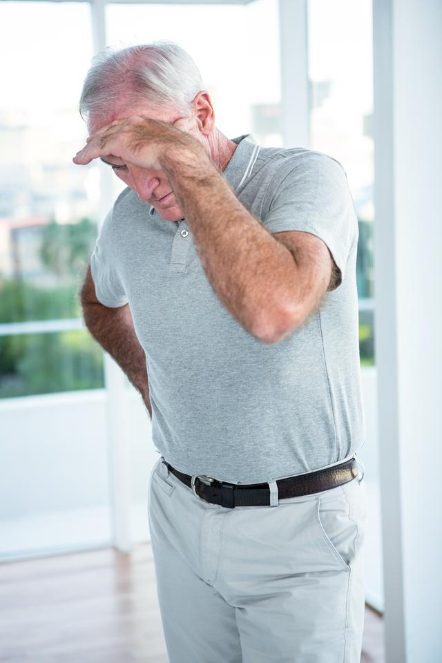 """Mature depressed man standing"" stock image"