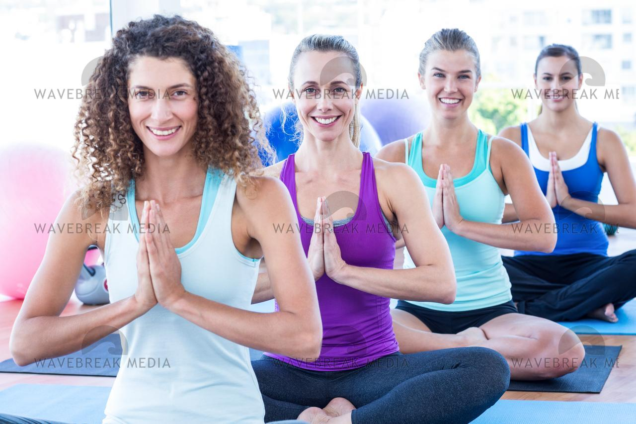 """Portrait of women doing easy pose with hands joined"" stock image"