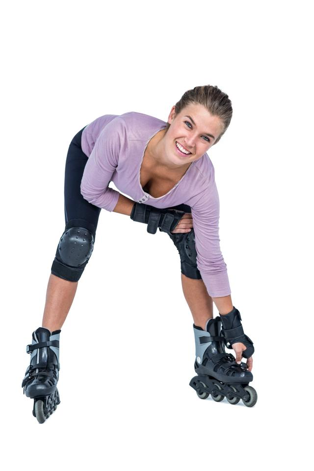 """Portrait of happy woman inline skating"" stock image"