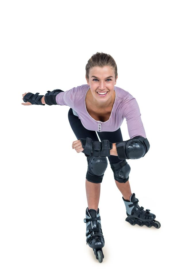 """Portrait of happy young woman inline skating"" stock image"