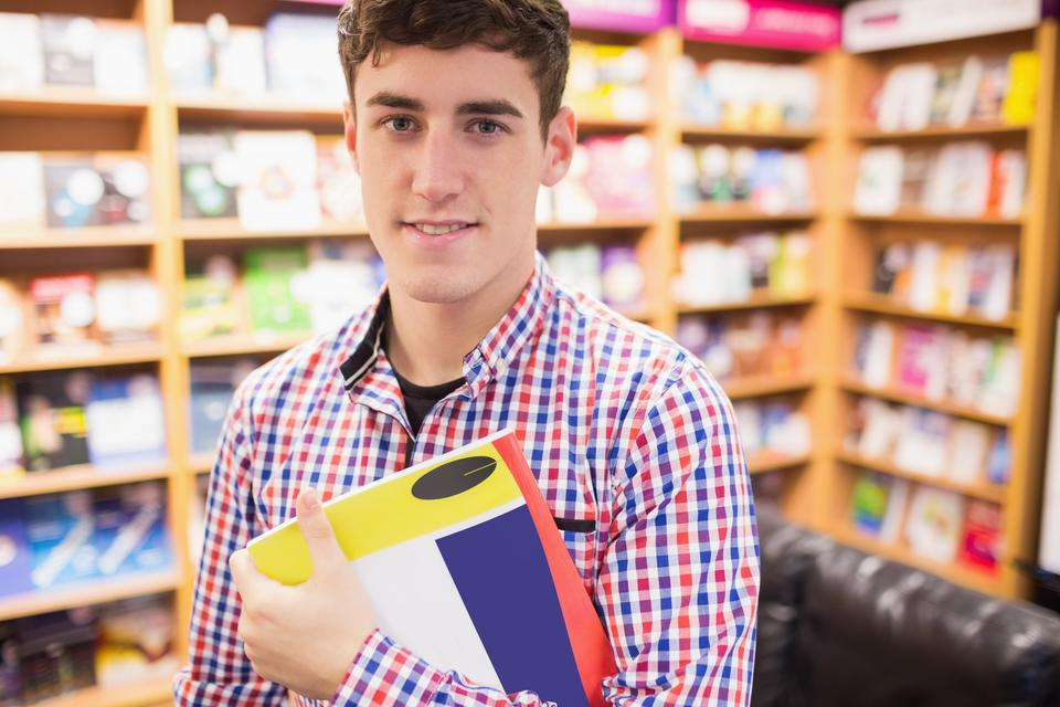 """Confident young man with book"" stock image"