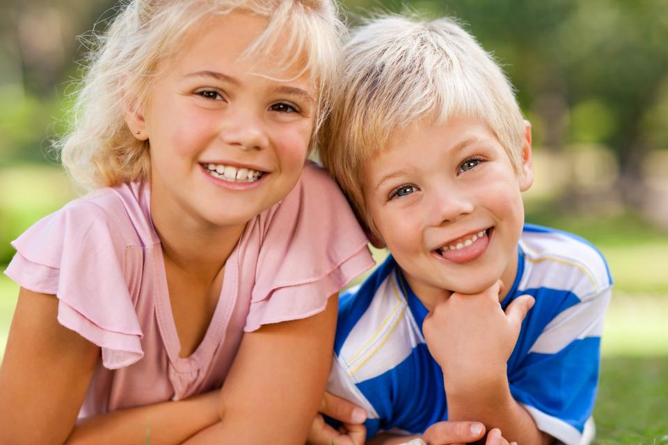 """""""Boy with his sister in the park"""" stock image"""