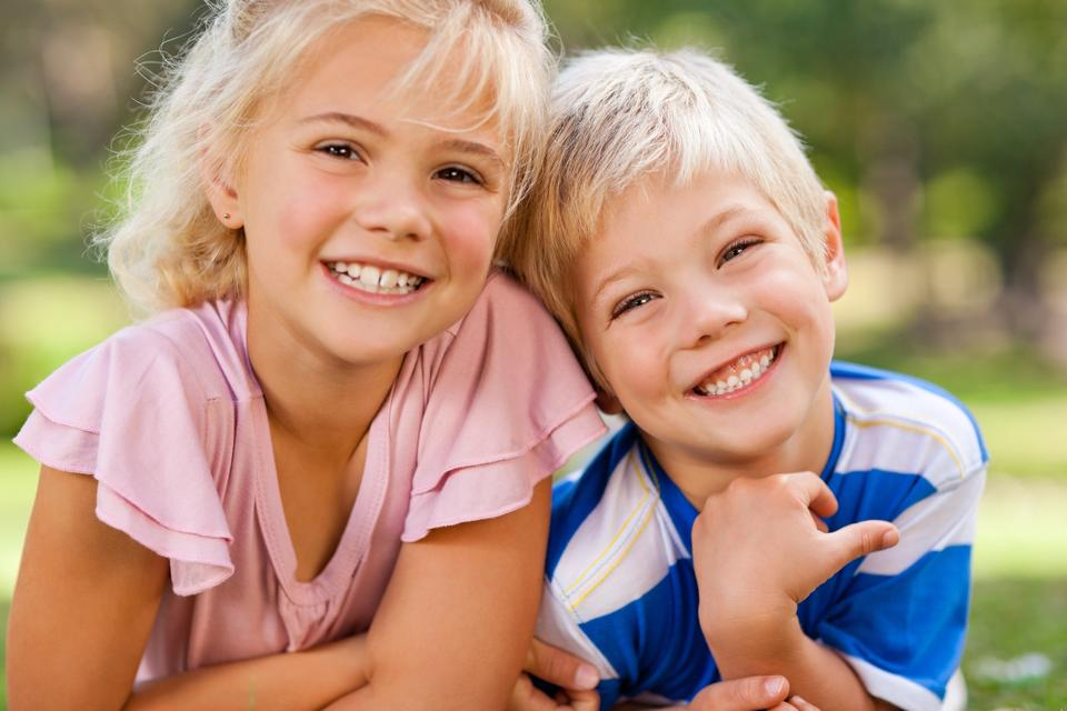 """""""Boy with his sister during the summer"""" stock image"""