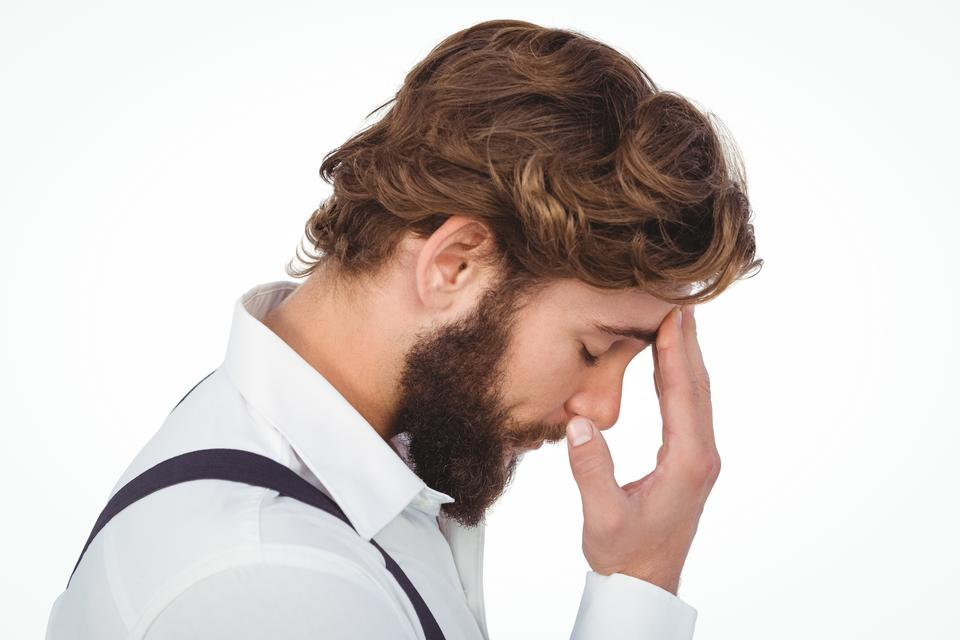 """""""Frustrated hipster with head in hand"""" stock image"""