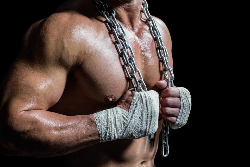"""""""Midsection of bodybuilder holding chain"""" stock image"""
