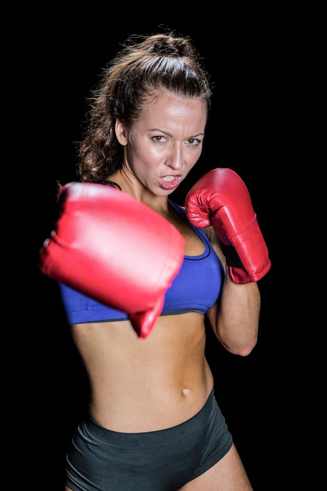 """Angry female fighter with gloves"" stock image"
