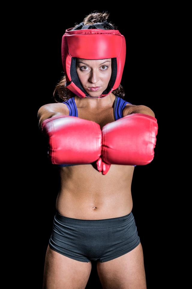 """Portrait of female fighter with gloves"" stock image"