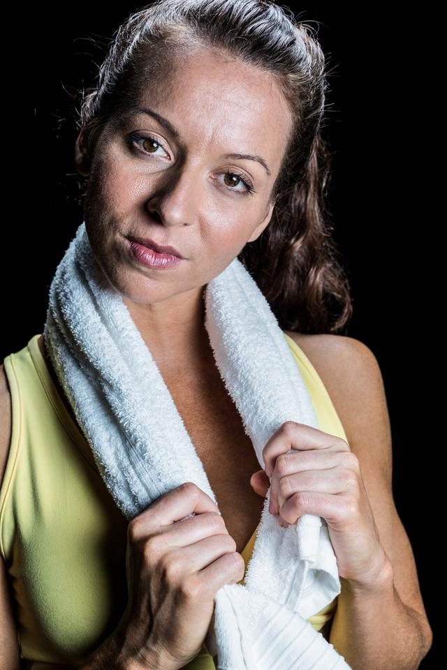 """Portrait of pretty athlete with towel around neck"" stock image"