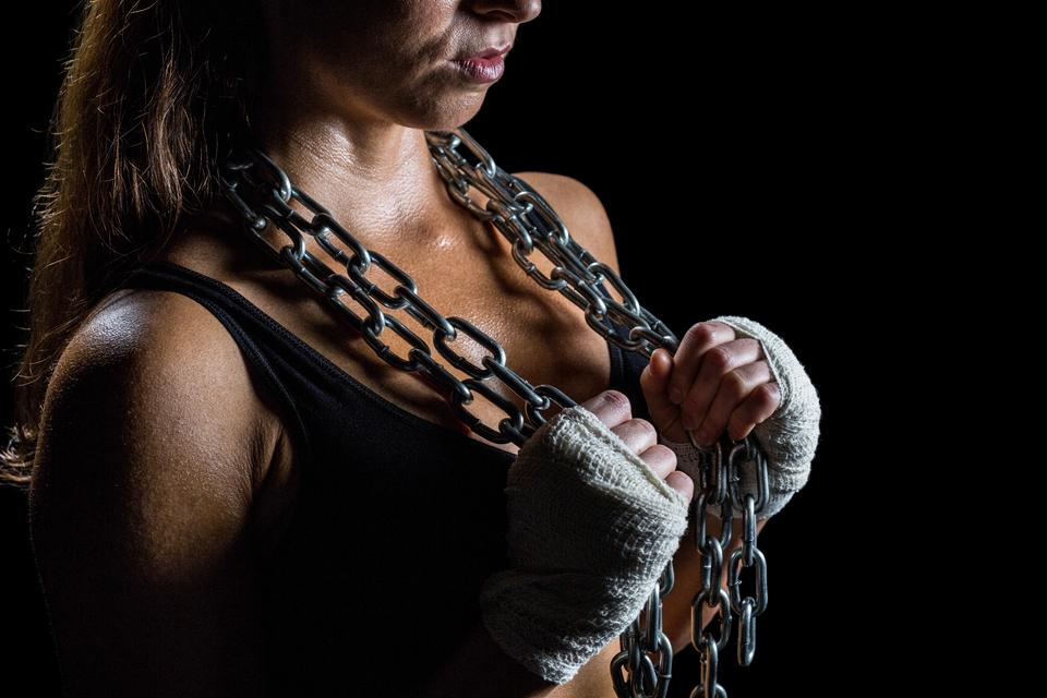 """Midsection of female athlete holding chain"" stock image"