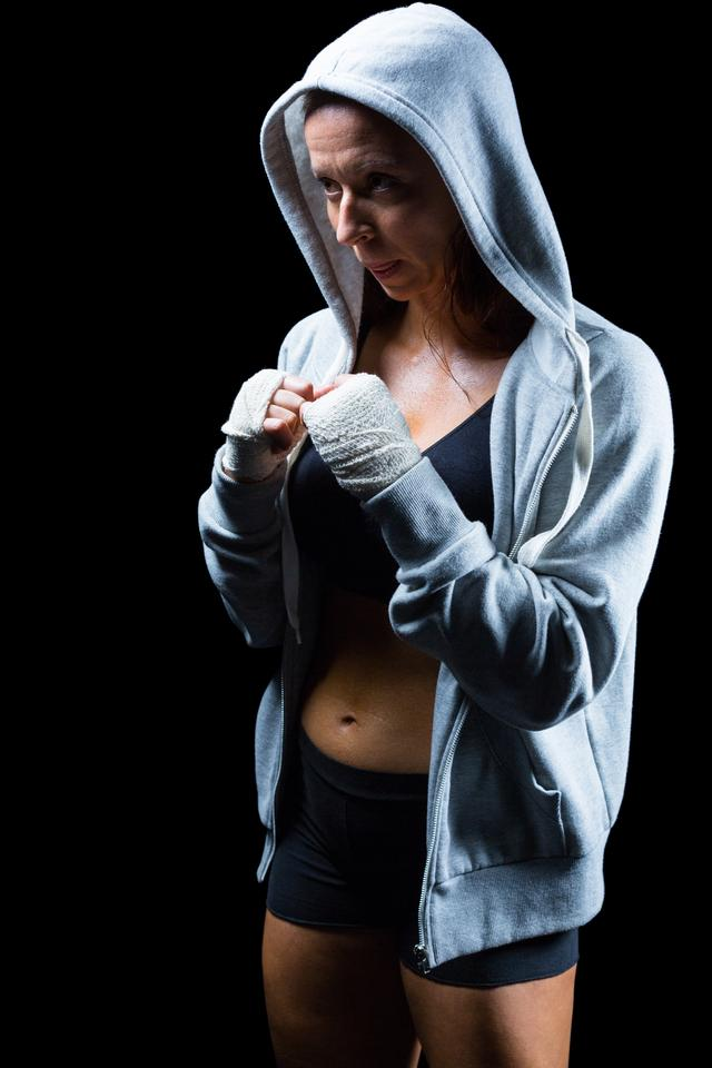 """Female fighter in hood with fighting stance"" stock image"