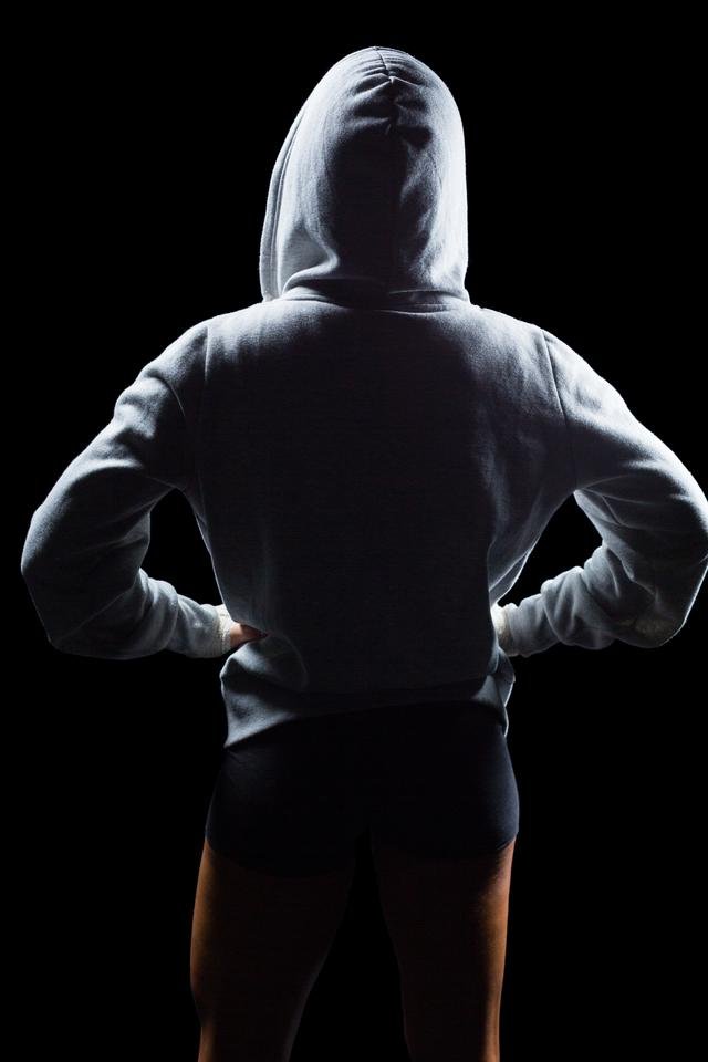 """Rear view of athlete in hood"" stock image"