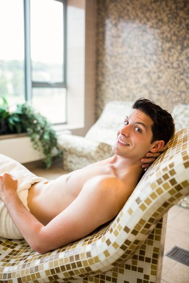 """""""Handsome man relaxing in thermal suite"""" stock image"""