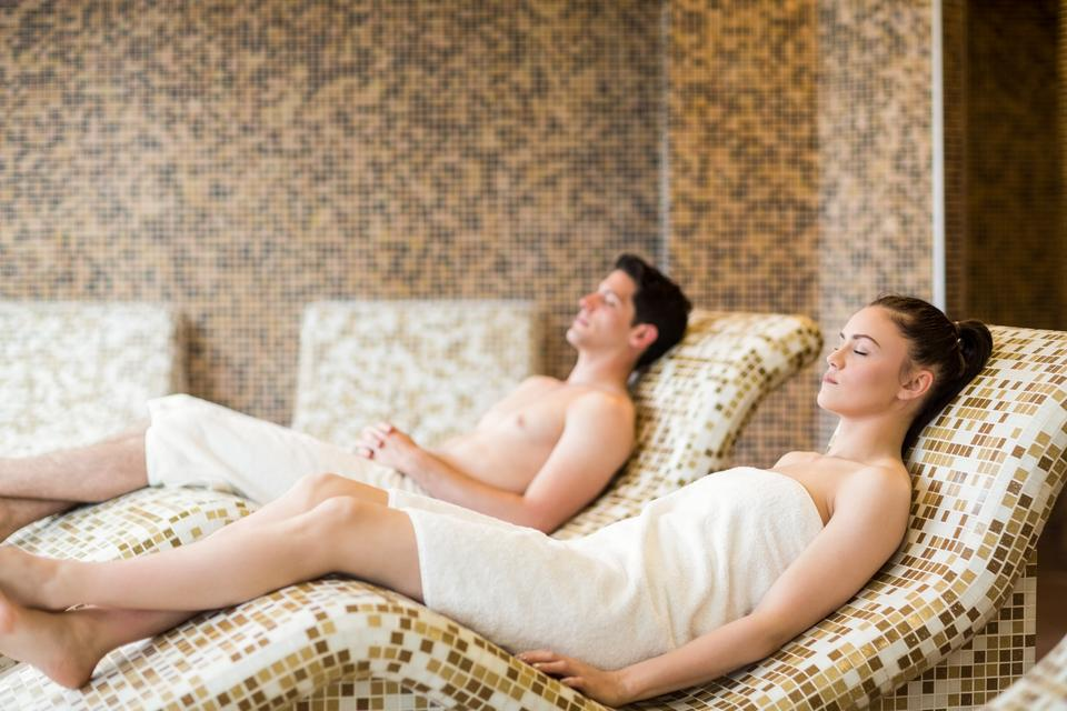 """Couple relaxing in the thermal suite"" stock image"