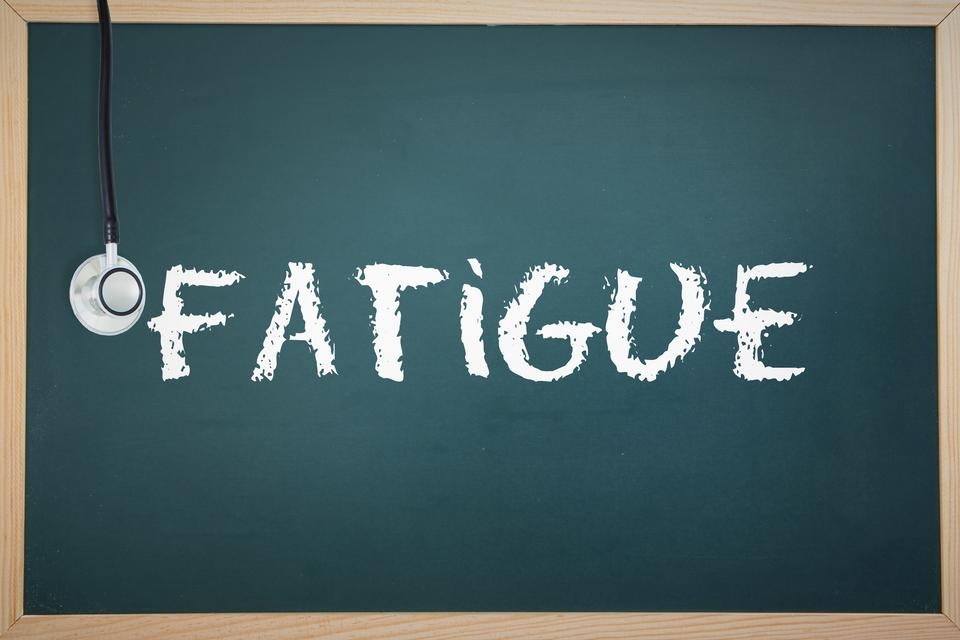 """""""Fatigue against chalkboard"""" stock image"""