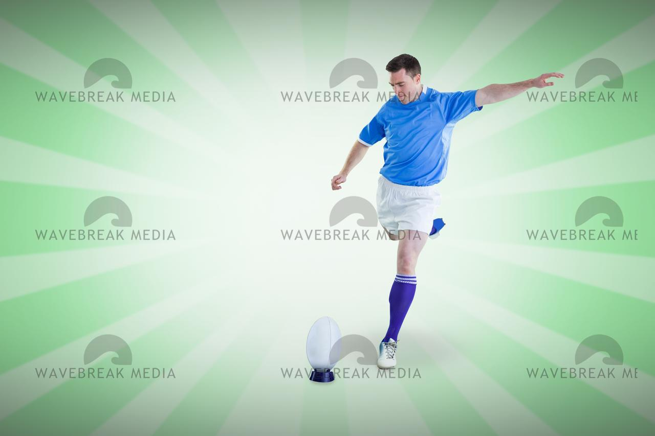 Composite image of rugby player doing a drop kick - License