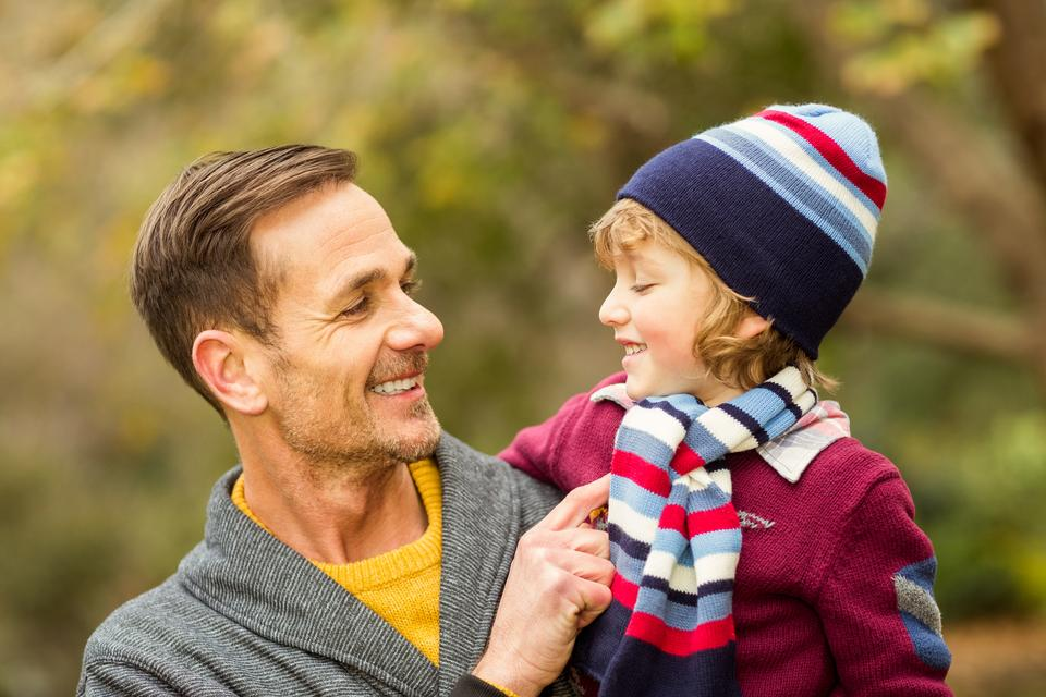 """Happy father and son looking at each other"" stock image"