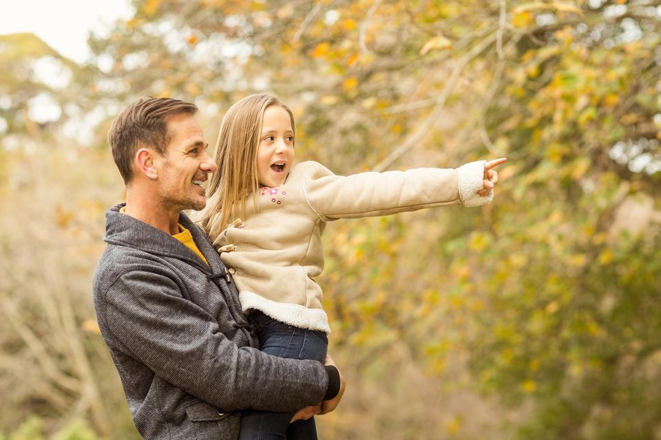 """Cute little girl showing her father something"" stock image"