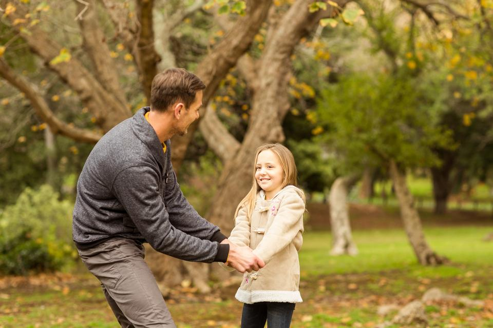 """Cute little girl playing with her father"" stock image"