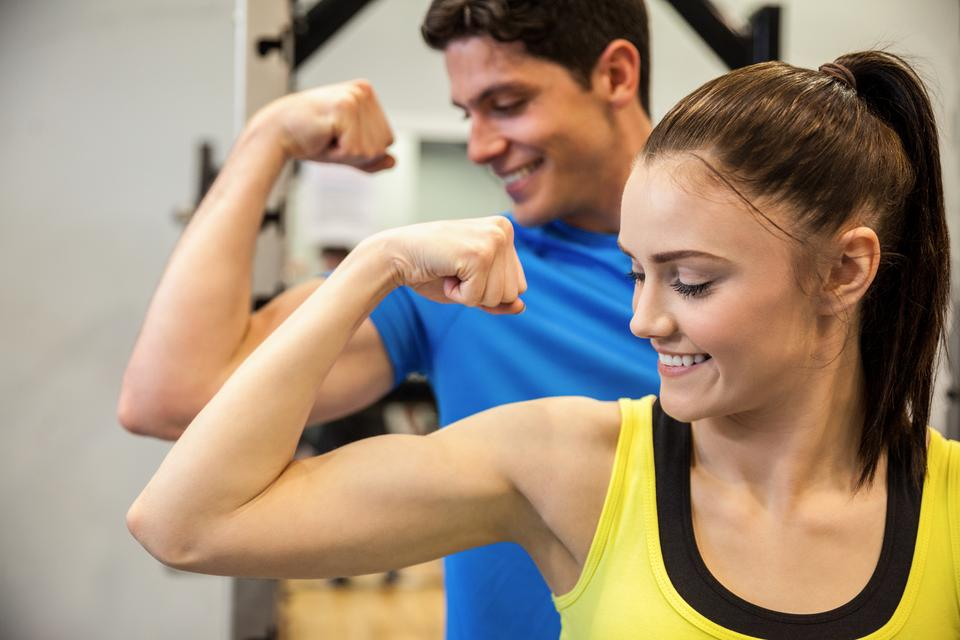 """""""Happy couple showing off their biceps"""" stock image"""