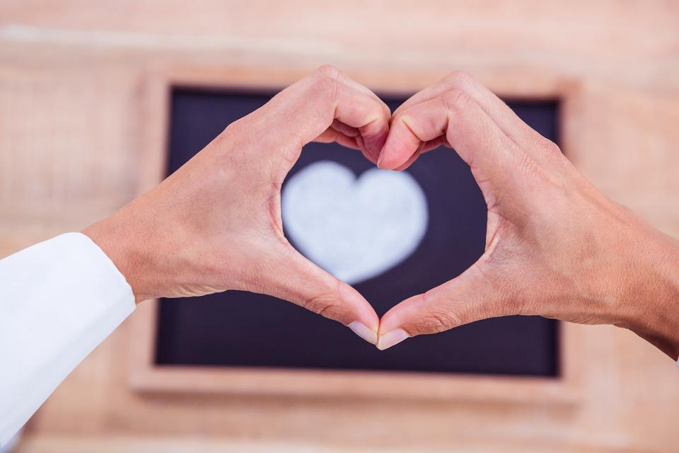 """""""View of hands making heart shape"""" stock image"""