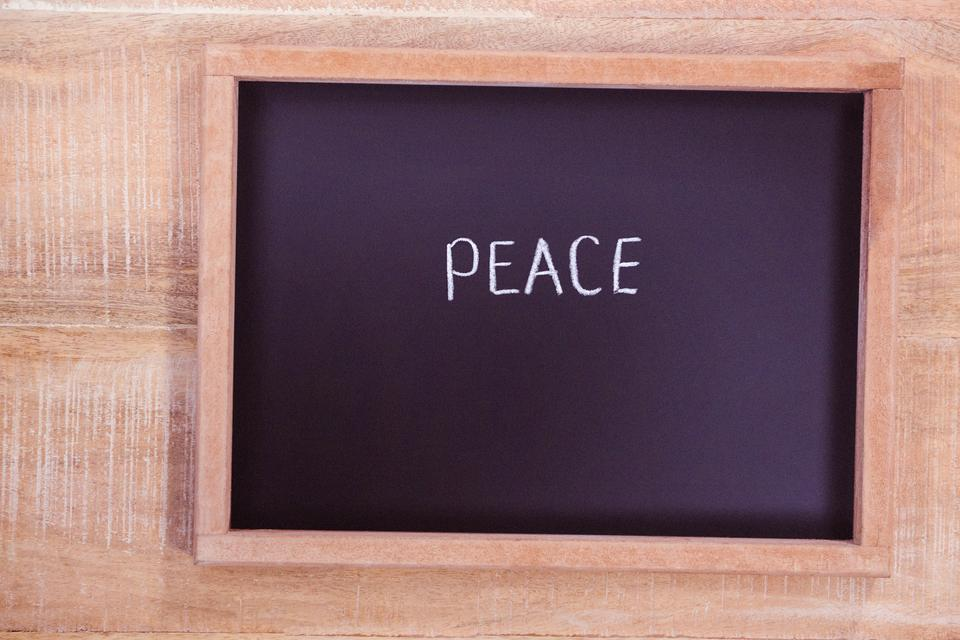"""""""Chalkboard with peace text"""" stock image"""