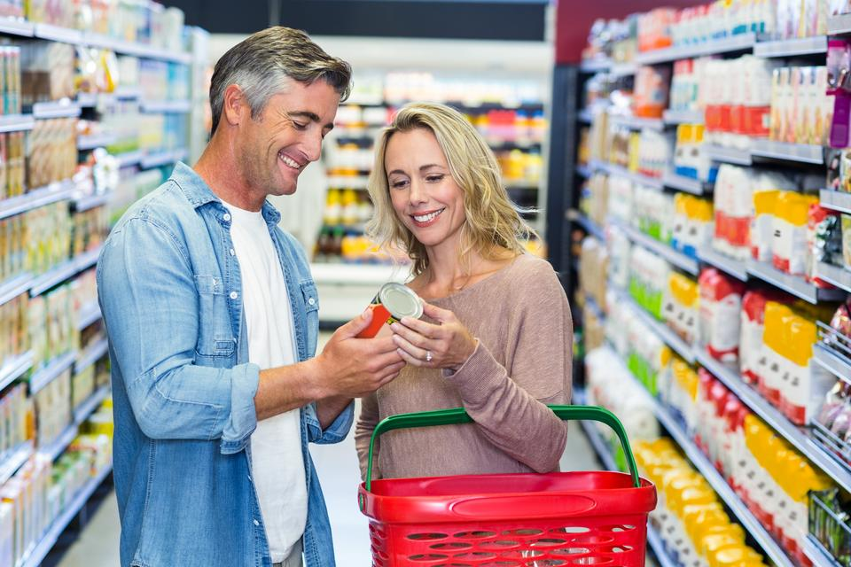 """""""Smiling couple holding canned food"""" stock image"""