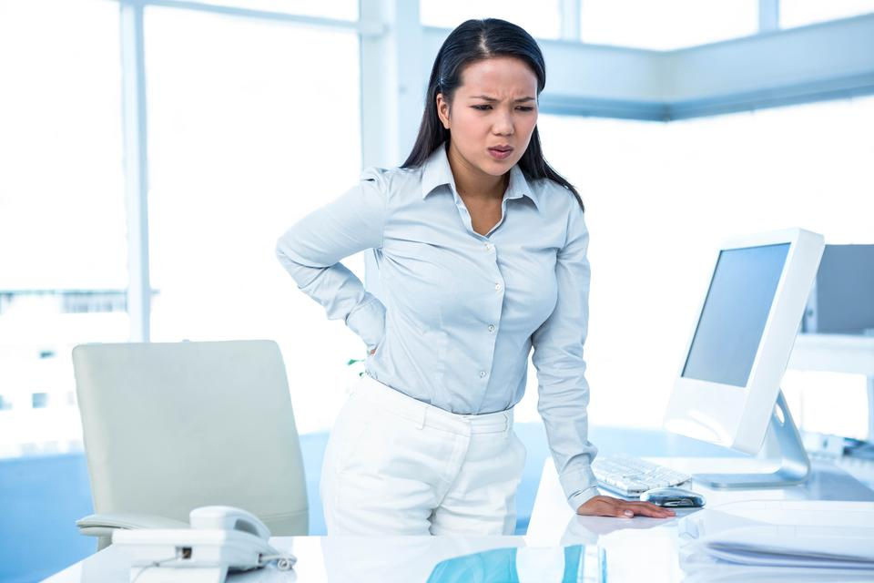 """""""Frowning businesswoman with back ache"""" stock image"""