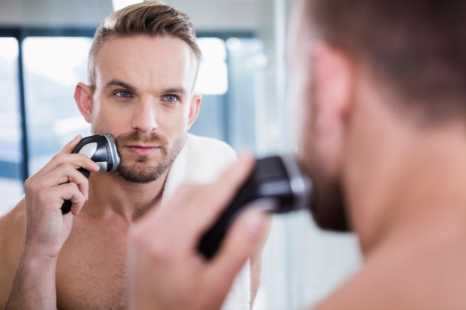 """""""Concentrated man shaving his beard"""" stock image"""