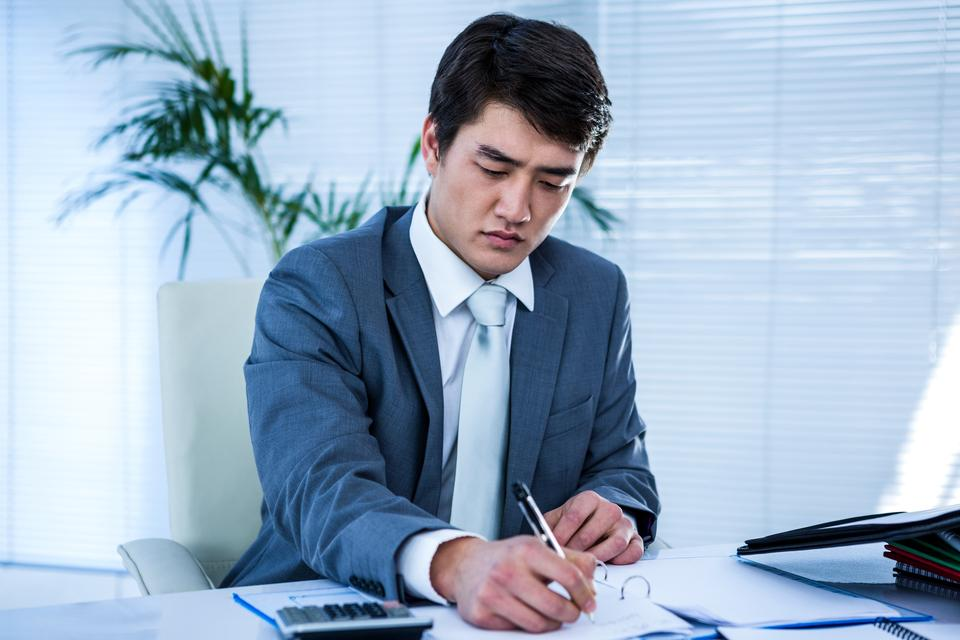 """""""Riled up asian businessman in his desk"""" stock image"""