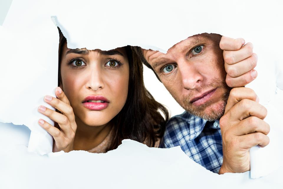 """Portrait of fearful couple"" stock image"