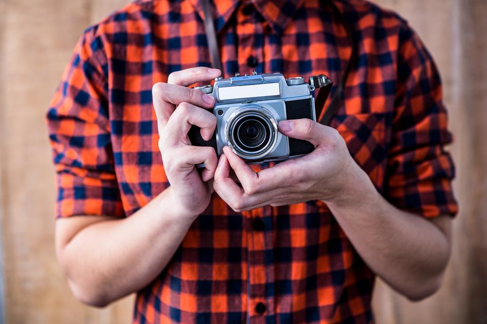 """""""Hipster holding an old camera"""" stock image"""