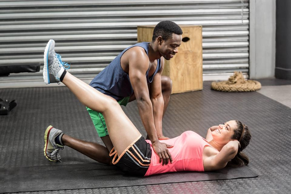 """""""Fit couple doing exercises"""" stock image"""