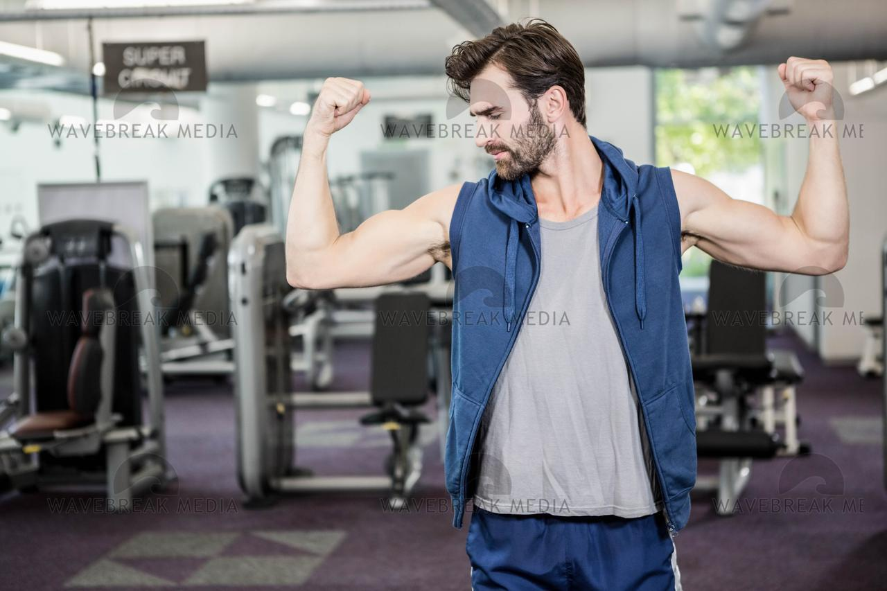 """Muscular man showing biceps"" stock image"