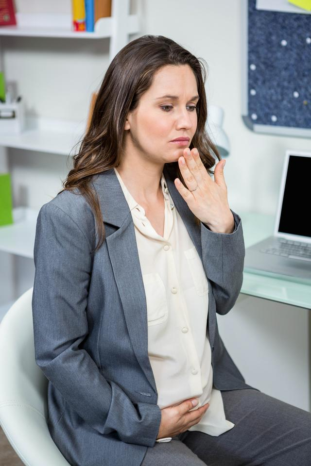"""""""Pregnant businesswoman getting morning sickness"""" stock image"""
