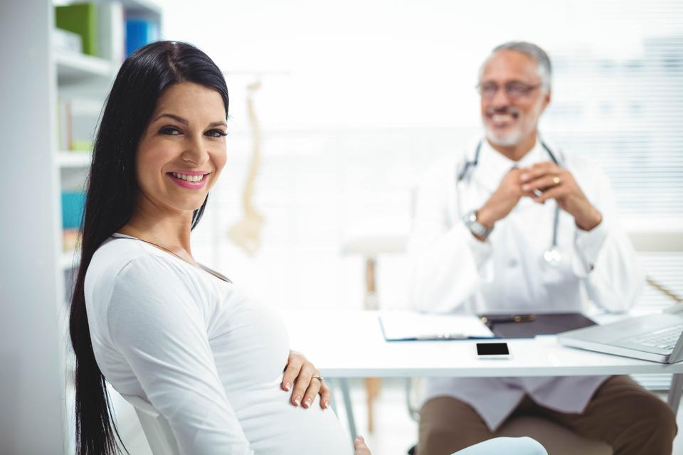 """""""Pregnant woman sitting at clinic for health checkup"""" stock image"""